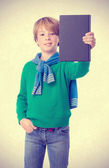 Satisfied child holding a book — Foto Stock