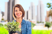 Young cool woman with a plant — Stock Photo