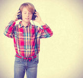 Boy listening music with an headphones — Stock Photo