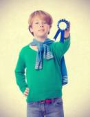 Proud child holding a medal — Stock Photo