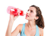 Healthy girl drinking water — Stock Photo