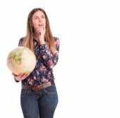 Thoughtful girl with a world globe — Stock Photo