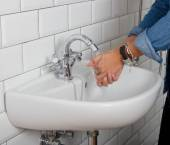Girl washing her hands — Stock Photo