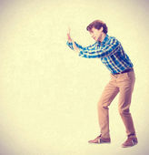 Young boy pushing gesture — Stock Photo