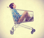 Teenager inside a shopping cart — Stock Photo