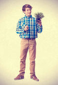 Teenager holding a plant — Stock Photo