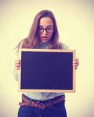 Young woman holding a blackboard — Stock Photo