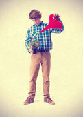 Teenager watering a plant — Stock Photo