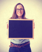 Young woman showing a blackboard — Stock Photo