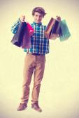 Teenager holding shopping bags — Stock Photo