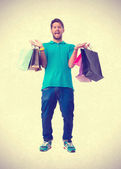 Teenager holding a shopping bags — Stockfoto