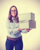 Young woman holding a boxes. isolated — Stock Photo