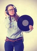 Young student with headphones and vinyl — Stock Photo