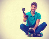 Guy sitting and holding a telephone — Stock Photo