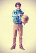 Teenager holding a world globe — Stock Photo