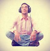 Young man listening music by headphones. — Stock Photo