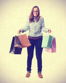 Young woman holding a shopping bags — Stock Photo