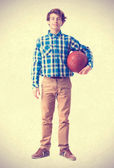 Teenager holding a basket ball — Stock Photo