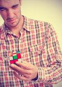 Unhappy boy solving a problem — Stock Photo