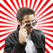 Young rocker man with sun glasses — Stock Photo