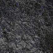 Black glossy rock texture — Fotografia Stock