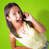 Woman speaking by mobile phone — Stock Photo