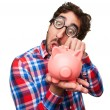 Crazy man with a piggy bank — Stock Photo #71093201