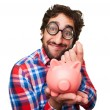 Crazy man with a piggy bank — Stock Photo #71094073