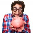Crazy man with a piggy bank — Stock Photo #71094653