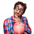 Crazy man with a piggy bank — Stock Photo #71096963