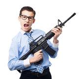 Businessman with a gun — Stock Photo