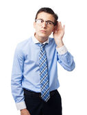 Businessman trying to listen — Stock Photo
