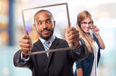 Young cool black man joking with steel frame — Stock Photo