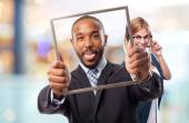 Young cool black man with a steel frame joking — Stock Photo
