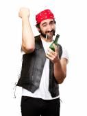 Motorcyclist man drinking — Stock Photo