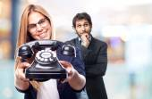 Young cool woman with a telephone — Stock Photo