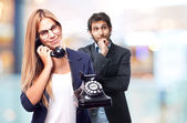 Young cool woman speaking with a telephone — Stock Photo