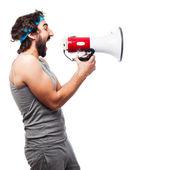 Sportsman with megaphone — Stock Photo