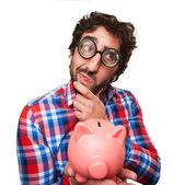 Crazy man with a piggy bank — Stock Photo