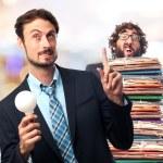 Young crazy businessman having an idea — Stock Photo #71169833