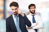 Young crazy businessman intelligence gesture — Stock Photo