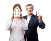 Blond woman with a small house — Stock Photo