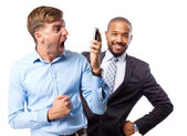 Blond man shouting on phone — Stock Photo