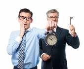 Businessman with a clock — Stock Photo