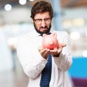 Businessman with piggy bank — Stock Photo