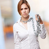 Blond woman with chains — Stock Photo