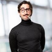 Pedantic man smoking — Stock Photo