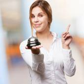 Blond woman with call bell — Stock Photo