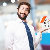 Businessman with a house — Stock Photo