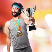 Sportsman with medals and cup — Stock Photo